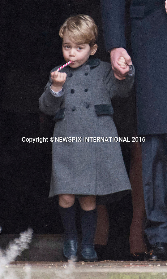 25.12.2016; Englefield, UK: PRINCE GEORGE AND PRINCESS CHARLOTTE - 1ST XMAS SERVICE<br /> The Duke and Duchess of Cambridge took Prince George and Princess Charlotte to their first Christmas Day church service at St Mark&rsquo;s Church, Englefield. <br /> While the rest of the royals attended church service at Sandringham.<br /> Picture Shows: Prince George with a candy rock in his mouth.<br /> Mandatory Photo Credit: &copy;Francis Dias/NEWSPIX INTERNATIONAL<br /> <br /> IMMEDIATE CONFIRMATION OF USAGE REQUIRED:<br /> Newspix International, 31 Chinnery Hill, Bishop's Stortford, ENGLAND CM23 3PS<br /> Tel:+441279 324672  ; Fax: +441279656877<br /> Mobile:  07775681153<br /> e-mail: info@newspixinternational.co.uk<br /> Usage Implies Acceptance of OUr Terms &amp; Conditions<br /> Please refer to usage terms. All Fees Payable To Newspix International