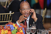 President Jacob Zuma of South Africa talks on the phone during a luncheon hosted by United Nations Secretary-General Ban Ki-moon at the 70th annual UN General Assembly at the UN headquarters September 28, 2015 in New York City. <br /> Credit: Chip Somodevilla / Pool via CNP