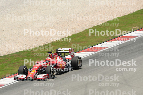 KUALA LUMPUR, MALAYSIA - MARCH 28: Ferrari driver Kimi Räikkönen in action during the second practice session during the Malaysia Formula One Grand Prix at the Sepang Circuit on March 28, 2014 in Kuala Lumpur, Malaysia. (Photo by PETER LIM/PhotoDesk.com.my)
