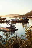 USA, Alaska, Sitka, fishing boats docked in Sitka Harbor at sundown