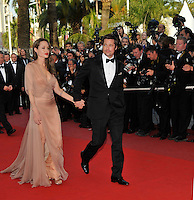 BRAD PITT &amp; ANGELINA JOLIE<br /> The &quot;Inglourious Basterds&quot; Premiere at the Grand Theatre Lumiere during the 62nd Annual Cannes Film Festival, Cannes, France.<br /> May 20th, 2009<br /> full length black tuxedo suit cream beige brown pink dress sheer long one shoulder tattoos couple holding hands slit split low cut neckline wrap<br /> CAP/PL<br /> &copy;Phil Loftus/Capital Pictures /MediaPunch ***NORTH AND SOUTH AMERICAS ONLY***