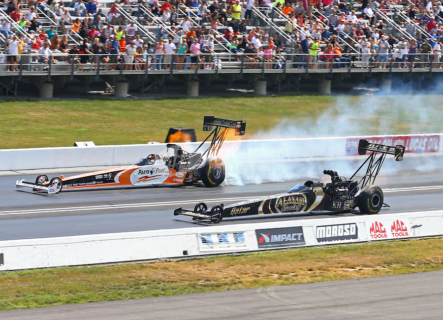 Sept. 2, 2013; Clermont, IN, USA: NHRA top fuel dragster driver Clay Millican (far lane) smokes the tires alongside Khalid Albalooshi during the US Nationals at Lucas Oil Raceway. Mandatory Credit: Mark J. Rebilas-
