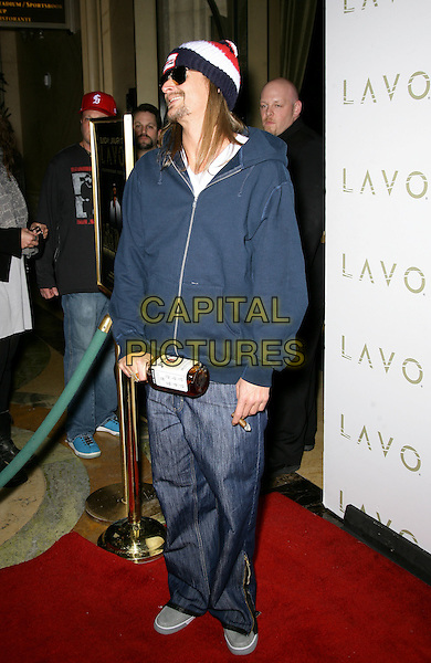 KID ROCK (Robert James Ritchie).Kid Rock celebrates his birthday at LAVO inside the Palazzo Resort Hotel and Casino, Las Vegas, Nevada, USA..January 17th, 2010.full length sunglasses shades beanie hat goatee facial hair blue zip zipper top hooded jeans denim cigar smoking jim beam bottle booze alcohol drink profile .CAP/ADM/MJT.©MJT/Admedia/Capital Pictures