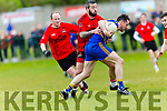 Ballymac's Luke Sweeney is closed down by Fossa's Anthony Wharton and Mark Dennehy  at the Junior Premier Club Football Championship 2017 Round 1 Ballymac v Fossa at Ballymacelligott GAA Ground on Sunday
