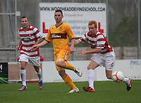 Robert McHugh clears up before being tackled by Ziggy Gordon in the Hamilton Academical v Motherwell friendly match played at New Douglas Park, Hamilton on 24.7.12..