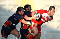PICTURE BY VAUGHN RIDLEY/SWPIX.COM...Rugby League - International Friendly - England Knights v France - Leigh Sports Village, Leigh, England - 15/10/11…England's Joe Westerman is tackled by France's Jean-Philippe Baille and Eloi Pelissier.