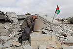 A Palestinian man inspects a well amidst the rubble of the home of Mohammed Abed Almajid El-Amaira, a Palestinian accused of involvement in a shooting attack that led to the death of a rabbi, after it was destroyed by Israeli military on August 30, 2016 in the West Bank village of Dura near Hebron. Israel frequently destroys the homes of Palestinians who have carried out attacks. Amaira, a member of the Palestinian Authority security services, was arrested several weeks ago, accused of having helped plan and carry out the attack on July 1, when gunmen opened fire on a car near Hebron. The car crashed, killing rabbi Michael Mark, who led a religious school in the Israeli settlement of Otniel, and wounding two family members, according to the army. Photo by Wisam Hashlamoun