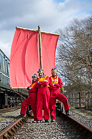 BNPS.co.uk (01202 558833)<br /> Pic: PhilYeomans/BNPS<br /> <br /> Phil and his team prepare to launch on the Midland Railway near Butterley in Derbyshire.<br /> <br /> To Hull and back...eccentric Inventor Phil Mathison has recreated the almost forgotten 'Spurn Landship'.<br /> <br /> Railway enthusiast Phil Mathison, 68, has researched and rebuilt the sail powered Spurn Landship, which once ferried people out along the windswept Spurn Peninsula east of Hull between the wars.<br /> <br /> The original 13 ft landship, made up of a large sail mounted on a wheeled trolley (bogie), could travel at a hair-raising 40mph. <br /> <br /> Mr Mathison, a retired economist, has been assisted on the four year project by his wife Mary, 68, and their Norwegian friend Torkel Larsen, 51. The trio have dubbed themselves the 'Spurnfleet Command' and wear astronaut-like uniforms.<br /> <br /> Despite exhaustive trials Phil and his team have only attained a top speed of 6mph so far, mainly due to fluctuating wind conditions on the test track in Derbyshire.