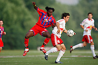 Crystal Palace forward Gary Brooks (30) and New York Red Bulls defender Carlos Mendes (4) battle for the ball. Crystal Palace FC USA of Baltimore (USL2) defeated the New York Red Bulls (MLS) 2-0 during a Lamar Hunt US Open Cup third round match at Lawrence E. Knight Stadium in Annapolis, Maryland, on July 01, 2008.