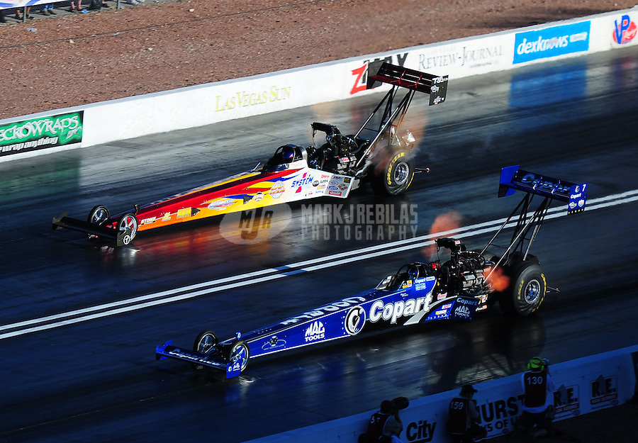 Apr. 1, 2011; Las Vegas, NV, USA: NHRA top fuel dragster driver Brandon Bernstein (bottom) races alongside Steve Faria during qualifying for the Summitracing.com Nationals at The Strip in Las Vegas. Mandatory Credit: Mark J. Rebilas-