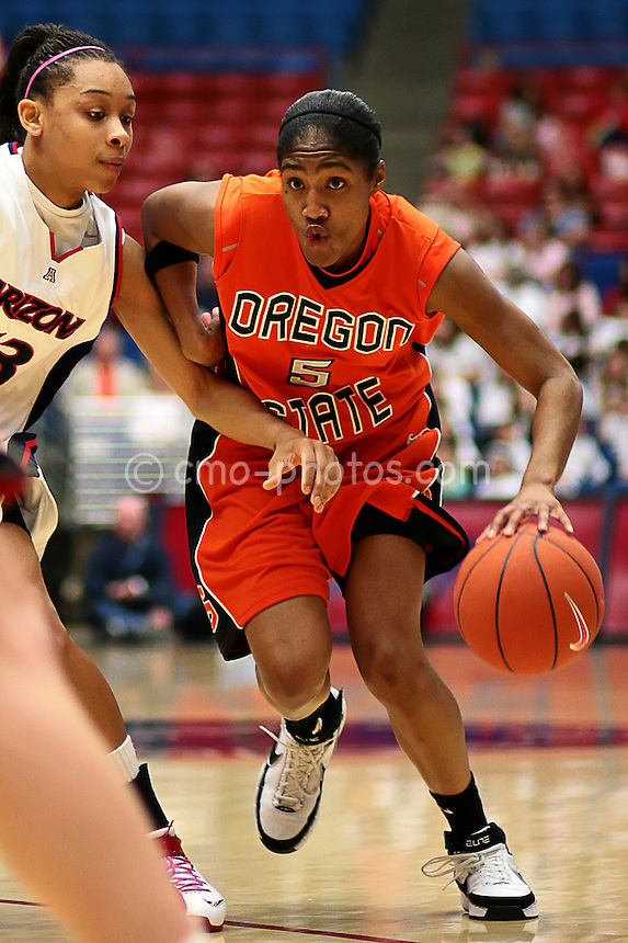 Feb 2, 2008; Tucson, AZ, USA; Oregon State Beavers guard Ashley Allen dribbles past Arizona Wildcats guard Tasha Dickey during a game at the McKale Center.  The Wildcats won the game 71-63.