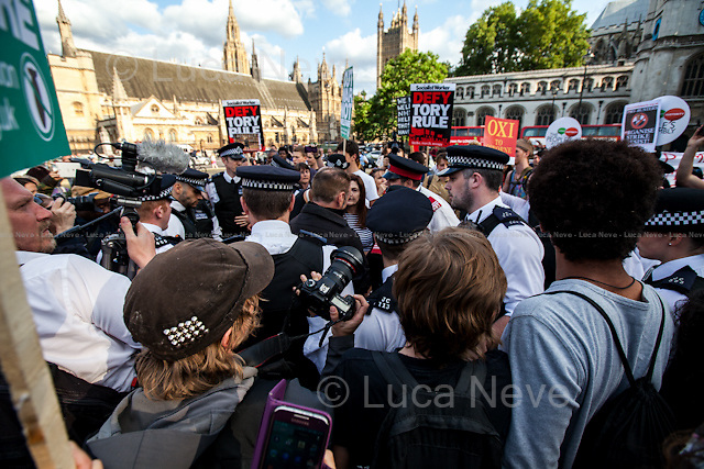 London, 08/07/2015. Today, The People's Assembly Against Austerity supported by other organizations held a mass die-in in Parliament Square and then marched to the gates of Downing Street to protest against the Second Budget 2015 presented during the day by the Chancellor of the Exchequer, George Osborne.<br /> <br /> For more information please click here: http://on.fb.me/1Rn7GJX &amp; http://www.thepeoplesassembly.org.uk/