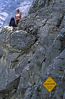 CANADA, ALBERTA, KANANASKIS, MAY 2002. A hiker prepares to scramble down the rocks next to the Ribbon Falls.  The Kananaskis Country provincial park is home to Canada's most beautiful nature and wildlife. It has also escaped the mass tourism as in Banff National Park. Photo by Frits Meyst/Adventure4ever.com
