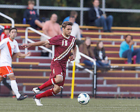 Boston College midfielder Giuliano Frano (15) brings the ball forward. Boston College (maroon) defeated Syracuse University (white/orange), 3-2, at Newton Campus Field, on October 8, 2013.