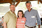 Watertown, CT- 18 May 2017-051817CM21- SOCIAL MOMENTS-- From left, Bob Burns, executive director at the  Mattatuck Museum with Colleen and Lenny Genovese of Southbury are photographed during the annual Greater Waterbury Campership Fund picnic at Camp Mataucha in Watertown on Thursday.   Christopher Massa Republican-American