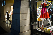 A Chinese man walks past a shop at The Venetian Macau Resort Hotel in Macau, China.