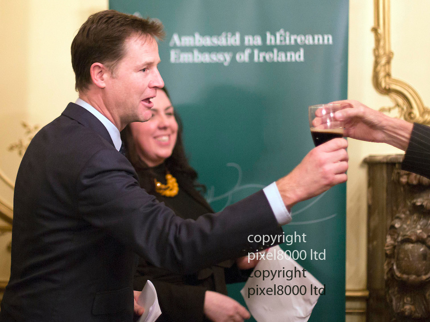 Pic shows: Nick Clegg gave a speech at the Journalists Charity fund raiser at the Irish Embassy in London last night.<br /> <br /> He also chatted with Jeremy Paxman, who was telling anyone who would listen that Clegg had &quot;told the biggest lie in the history of British Politics when he signed that pledge on tuition fees.&quot;<br /> <br /> Both Clegg and Paxman were drinking halves of Guinness as was appropriate<br /> <br /> <br /> <br /> <br /> Pic by Gavin Rodgers/Pixel 8000 Ltd