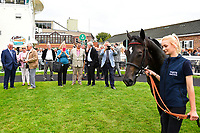 Connections of Field of Vision watch their horse in the winners enclosure during Afternoon Racing at Salisbury Racecourse on 7th August 2017