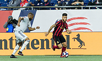 Foxborough, Massachusetts - April 13, 2019: In a Major League Soccer (MLS) match, Atlanta United FC (red/black) defeated New England Revolution (white), 2-0, at Gillette Stadium.