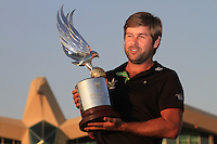 Robert Rock (ENG) holding the trophy for the media after his win at the Abu Dhabi HSBC Golf Championship, Abu Dhabi GC,Abu Dhabi,United Arab Emirates.Picture Fran Caffrey www.golffile.ie