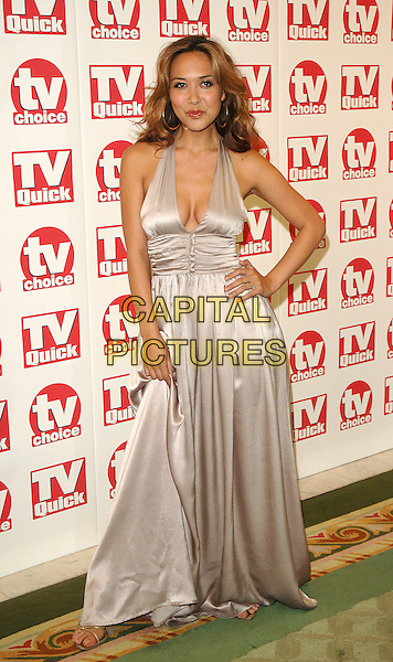 MYLEENE KLASS.The TV Quick and TV Choice Awards, The Dorchestr, London, UK..September 4th, 2006.Ref: BEL.full length beige dress satin hand on hip halterneck.www.capitalpictures.com.sales@capitalpictures.com.©Tom Belcher/Capital Pictures.