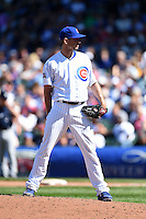 Chicago Cubs pitcher Jacob Turner (38) looks in for the sign during a game against the Milwaukee Brewers on August 14, 2014 at Wrigley Field in Chicago, Illinois.  Milwaukee defeated Chicago 6-2.  (Mike Janes/Four Seam Images)