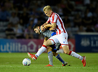 Lincoln City's Tom Pett vies for possession with Stoke City's Lasse Sorensen<br /> <br /> Photographer Chris Vaughan/CameraSport<br /> <br /> Football Pre-Season Friendly - Lincoln City v Stoke City - Wednesday July 24th 2019 - Sincil Bank - Lincoln<br /> <br /> World Copyright © 2019 CameraSport. All rights reserved. 43 Linden Ave. Countesthorpe. Leicester. England. LE8 5PG - Tel: +44 (0) 116 277 4147 - admin@camerasport.com - www.camerasport.com