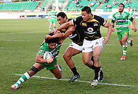 Wellington's Robert Fruean and Alapati Leiua tackle Tevita Tuifau during the Air NZ Cup preseason match between Manawatu Turbos and Wellington Lions at FMG Stadium, Palmerston North, New Zealand on Friday, 17 July 2009. Photo: Dave Lintott / lintottphoto.co.nz