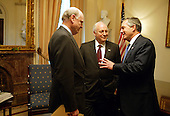 After casting the deciding vote for Congressional approval of a $350 billion jobs and growth package, United States Vice President Dick Cheney talks with United States Secretary of the Treasury John Snow, left, and United States Secretary of Commerce Don Evans in his Senate office at the United States  Capitol Friday, May 23, 2003.<br /> Mandatory Credit: David Bohrer / WH via CNP