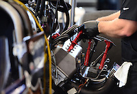 Sept. 22, 2012; Ennis, TX, USA: NHRA crew members for top fuel dragster driver Brandon Bernstein work on spark plug wires during qualifying for the Fall Nationals at the Texas Motorplex. Mandatory Credit: Mark J. Rebilas-