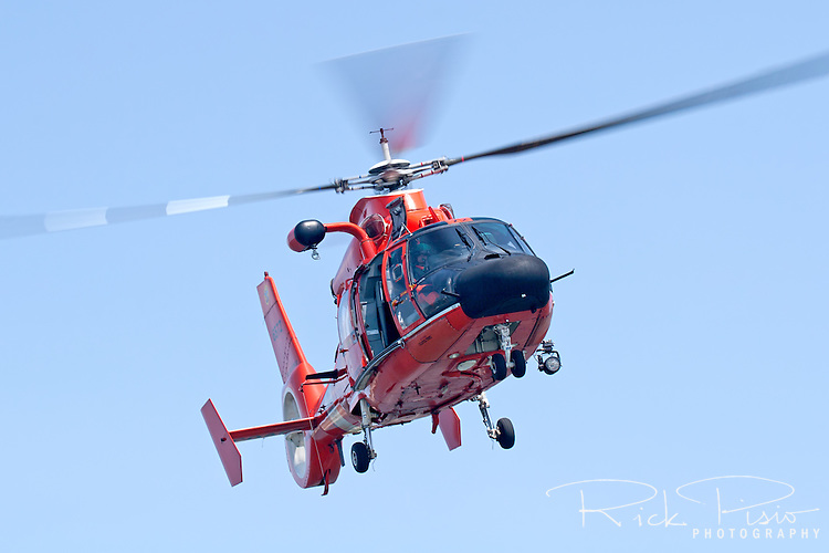 A United States Coast Guard HH-65C Dolphin helicopter approaching a Coast Guard Auxiliary vessel. The helicopter and crew, based at U.S. Coast Guard Air Station San Francisco, was on a practice mission with the Coast Guard Auxilary to maintain search and rescue proficiency.