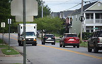 Traffic moves along Wednesday, July 22, 2020, on Zion Road near the intersection of Randal Place in Fayetteville. The City Council on Tuesday approved construction contracts to do improvement work on the street from Vantage Drive to Crossover Road, a project that was originally included in the city's 2006 bond improvement program. Check out nwaonline.com/200726Daily/ and nwadg.com/photos for a photo gallery.<br /> (NWA Democrat-Gazette/David Gottschalk)