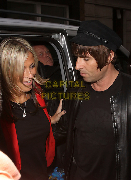 NICOLE APPLETON & LIAM GALLAGHER.At the Pretty Green Pop-Up store launch reception, Pretty Green, Carnaby Street, London, England, UK, July 29th 2010..half length black hat cap leather jacket  t-shirt red married couple husband wife .CAP/AH.©Adam Houghton/Capital Pictures.