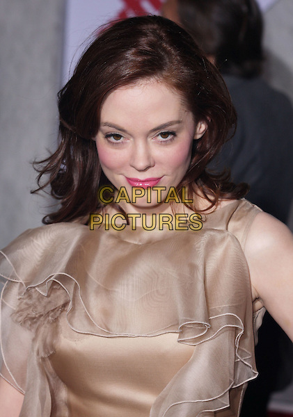 "ROSE McGOWAN .""When In Rome"" Los Angeles Premiere - Arrivals held at The El Capitan Theater, Hollywood, CA, USA, .27th January 2010..portrait headshot beige gold cream ruffle ruffles layered pink lipstick make-up lipgloss sleeveless .CAP/ADM/CH.©Charles Harris/AdMedia/Capital Pictures"