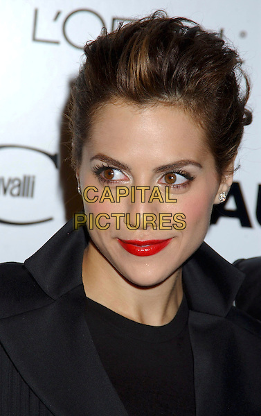"BRITTANY MURPHY .During ""Just Cavalli"" Flaunt Magazine's 6 Year Anniversary Party and Holiday Toy Drive to benefit Para Los Ninos held at a private residence in Los Angeles, California, USA, December 10th 2004..portrait headshot red lipstick brunette.Ref: ADM.www.capitalpictures.com.sales@capitalpictures.com.©Laura Farr/AdMedia/Capital Pictures ."