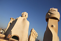 Chimneys with La Sagrada Familia in the distance, Roof, La Pedrera (Casa Milà), Barcelona, Catalonia, Spain, built by Antoni Gaudí (Reus 1852 ? Barcelona 1926), 1906 - 1910, for  Milà Family, with Joan Beltran as a plaster and with Josep Maria Jujol as architect collaborator. One of the main Gaudi residential buildings. Picture by Manuel Cohen