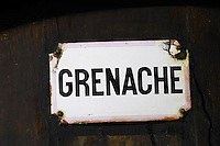 Grenache, rusty sign. Chateau de Nouvelles. Fitou. Languedoc. Barrel cellar. France. Europe.