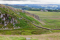 Northumberland,  England, UK.  Walking toward Peel Crags from Steel Rigg, Hadrian's Wall (Pennine Way) Footpath.