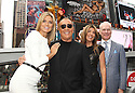 Heidi Klum, Michael Kors, Nina Garcia and Tim Gunn poses for photos while promoting the launch of the new season of Project Runway in Times Square on Thursday, July 19, 2012. (Photo by Donald Traill/Invision/AP)