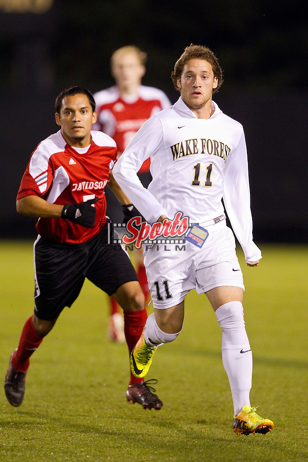 Luca Gimenez (11) of the Wake Forest Demon Deacons works to get position in front of Alex Givens (5) of the Davidson Wildcats at Spry Soccer Stadium on October 22, 2013 in Winston-Salem, North Carolina.  The Demon Deacons defeated the Wildcats 4-0.  (Brian Westerholt/Sports On Film)