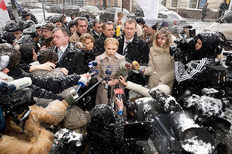 Opposition leader Yulia Tymoshenko is surrounded by journalists and supporters in downtown Kiev on January 25, 2011 before being questioned by investigators. Mrs. Tymoshenko stands accused of misspending some $280 million in state funds while serving as prime minister in 2009. Tymoshenko denies all wrongdoing.