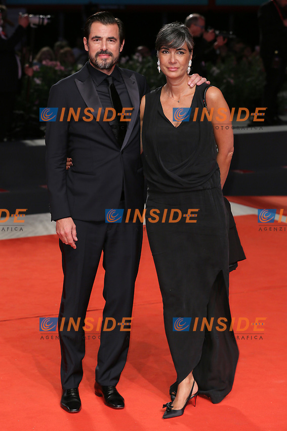 """VENICE, ITALY - SEPTEMBER 07: Claes Bang and Liz Louis-Jensen walk the red carpet ahead of the """"The Burnt Orange Heresy"""" during the 76th Venice Film Festival at Sala Grande on September 07, 2019 in Venice, Italy. (Photo by Mark Cape/Insidefoto)<br /> Venezia 07/09/2019"""