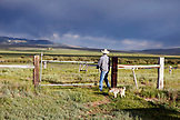 USA, Wyoming, Encampment, a cowboy enters a pasture through a gate, Big Creek Ranch