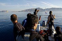 Divers heading towards a spot off the coast of Île de Riou, Marseille, France.