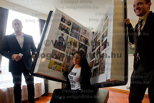 Hungarian model and celebrity Sylvi Bodi poses with the Book of One Million Messages during its official presentation in Budapest, Hungary on February 24, 2012. ATTILA VOLGYI
