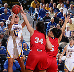 BROOKINGS, SD - JANUARY 17:  Kerri Young #10 from South Dakota State spots up for a jumper over  Kate Liveringhouse #34 and Jasmine Trimboli #5 from the University of South Dakota in the second half of their game Sunday afternoon at Frost Arena in Brookings, S.D. (Photo by Dave Eggen/Inertia)