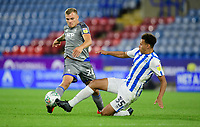 Lincoln City's Harry Anderson is tackled by Huddersfield Town's Rarmani Edmonds-Green<br /> <br /> Photographer Chris Vaughan/CameraSport<br /> <br /> The Carabao Cup First Round - Huddersfield Town v Lincoln City - Tuesday 13th August 2019 - John Smith's Stadium - Huddersfield<br />  <br /> World Copyright © 2019 CameraSport. All rights reserved. 43 Linden Ave. Countesthorpe. Leicester. England. LE8 5PG - Tel: +44 (0) 116 277 4147 - admin@camerasport.com - www.camerasport.com
