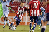 Chivas USA forward Alejandro Moreno (15) moves around traffic. Sporting KC defeated CD Chivas USA 3-2 at Home Depot Center stadium in Carson, California on Saturday March 19, 2011...