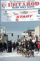 Peter Kaiser and team leave the ceremonial start line with an Iditarider at 4th Avenue and D Street in downtown Anchorage, Alaska on Saturday, March 5th during the 2016 Iditarod race. Photo by Joshua Borough/SchultzPhoto.com