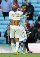 Andre Ayew of Swansea City consoles brother Jordan Ayew of Aston Villa at the final whistle after both brothers scored in the game but the swansea man got the winner during the Barclays Premier League match between Aston Villa v Swansea City played at the Villa Park Stadium, Birmingham on October 24th 2015
